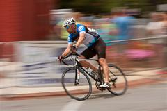 Motion blur of cyclist competing in georgia cup criterium Stock Photos