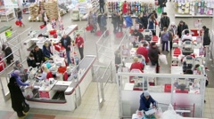 People pays cashier at superstore Auchan in Samara, Russia. Stock Footage