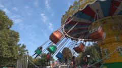 Colorful spinning wheel in amusement park. Fun park. Stock Footage