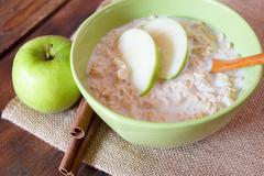Bowl of oatmeal with apples Stock Photos