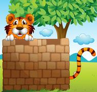 Stock Illustration of A  tiger hiding on a pile of bricks