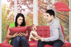 couple quarreling next to their child - stock photo