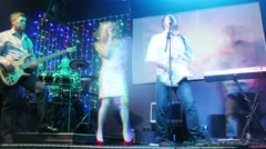 The group Watson with a woman soloist performs in nightclub - stock footage