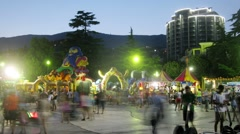 People walk on the area, which placed Attractions at evening Stock Footage