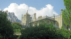 Clouds float over the Vorontsov Palace and mountains in Crimea Stock Footage