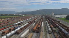 AERIAL: Busy industrial train station Stock Footage