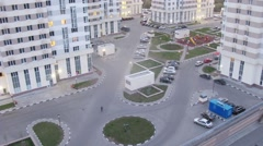 People and cars moving in a modern residential complex Stock Footage