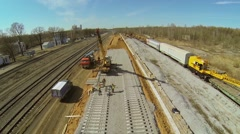 People build railway with crane at sunny day. Aerial view Stock Footage