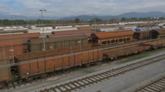 AERIAL: Freight trains on a railroad station Stock Footage