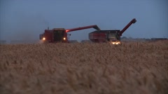 Combine tractor and grain cart harvest wheat Stock Footage