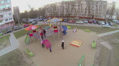 Family play on playground for kids near dwelling houses Stock Footage