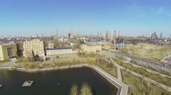 Small park with pond near Oil Refinery of Gazpromneft company Stock Footage