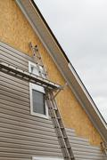 New Vinyl Siding Installation On A Home In The South - stock photo