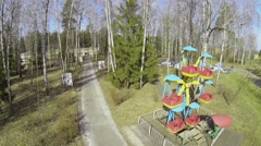 Amusements in park of kids camp at spring sunny day Stock Footage