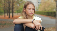 Sad And Lonely Teenage Girl Waiting For Cell Phone Call Outdoors HD Stock Footage