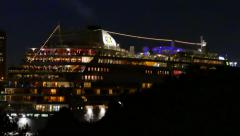4K UHD - Large cruise ship's rear packed with people at night in european city Stock Footage