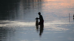 Silhouette of Man Fishing in the River in the Morning - Angkor Wat Stock Footage