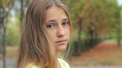 Portrait Of Sad Beautiful Young Woman Looking At Camera Outdoors HD Stock Footage