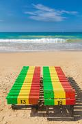 Colourful wooden deck chairs on unawatuna beach in sri lanka. Stock Photos