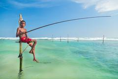 Young stilt fisherman at hikkaduwa beach. Stock Photos