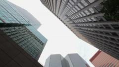 Low-Angle View Of City Buildings With 180 Degree Camera Rotation HD Stock Footage