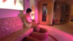 Woman in feet spa Stock Footage