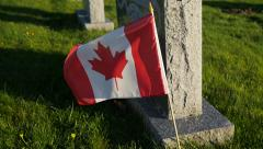 Slow motion - Canadian flag near tombstone Stock Footage