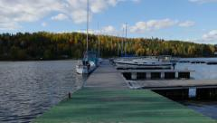 4K - Boat far at the dock - stock footage