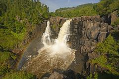 rainbow by spectacular falls in the summer - stock photo