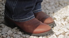 Farm - cowboy boots Stock Footage