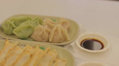 Pan - fresh green and white boiled dumplings, potstickers Stock Footage