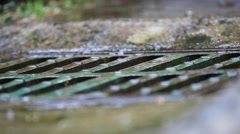 Raining over a  manhole Stock Footage