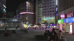 Evening - people sitting at Dunhua east metro mall square Barbiecafe Stock Footage