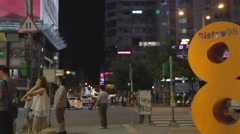 Taipei - pedestrians waiting for traffic - daan Stock Footage