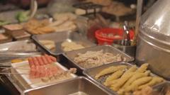 Taipei street food - sausages and assorted skewered food Stock Footage