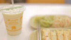 pan - dumplings and soy milk - stock footage