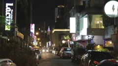 Car drives through alley in Taipei Dunhua Stock Footage