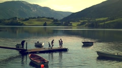 Playing on pier over the lake Stock Footage