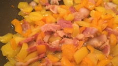 Orange and Yellow Bell Peppers cooked with bacon Stock Footage