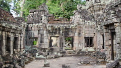 Stock Video Footage of Zoom Out of Stone Ruins of Abandon Temple  - Angkor Wat
