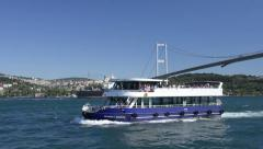 Blue excursion boat are navigating slowly with passengers at Bosphorus Edge Stock Footage