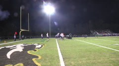 Extra point kick night game sideline view Stock Footage