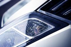 modern car headlight closeup. - stock photo