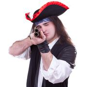 scary pirate with a gun in hands - stock photo