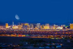 las vegas strip and the moon. las vegas panorama - stock photo