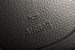 Steering wheel airbag symbol closeup photo. Stock Photos