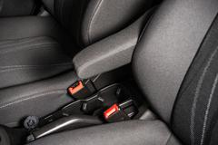 Economy car seats and seating belts closeup photo. Stock Photos