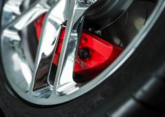red car brakes closeup and chromed alloy wheel. - stock photo
