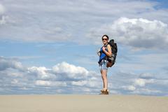 beautiful girl hiking in desert - stock photo