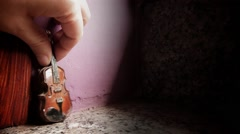 Put the music - A miniature cello is placed in the scene Arkistovideo